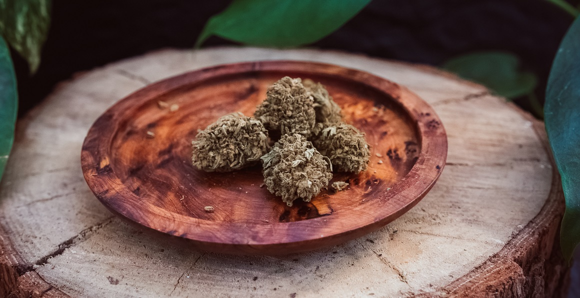 CBCV Flower nugs sitting on a wooden plate