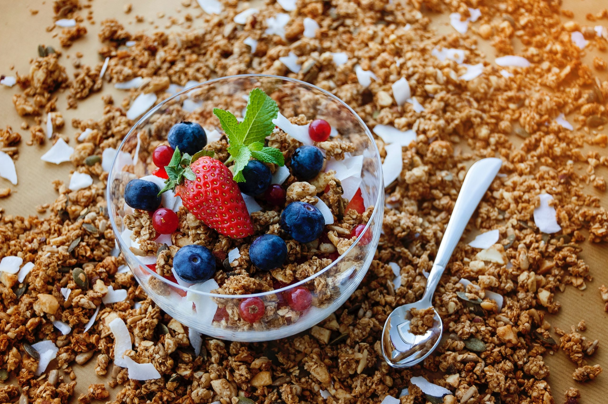 A bowl of hemp granola garnished with fruit