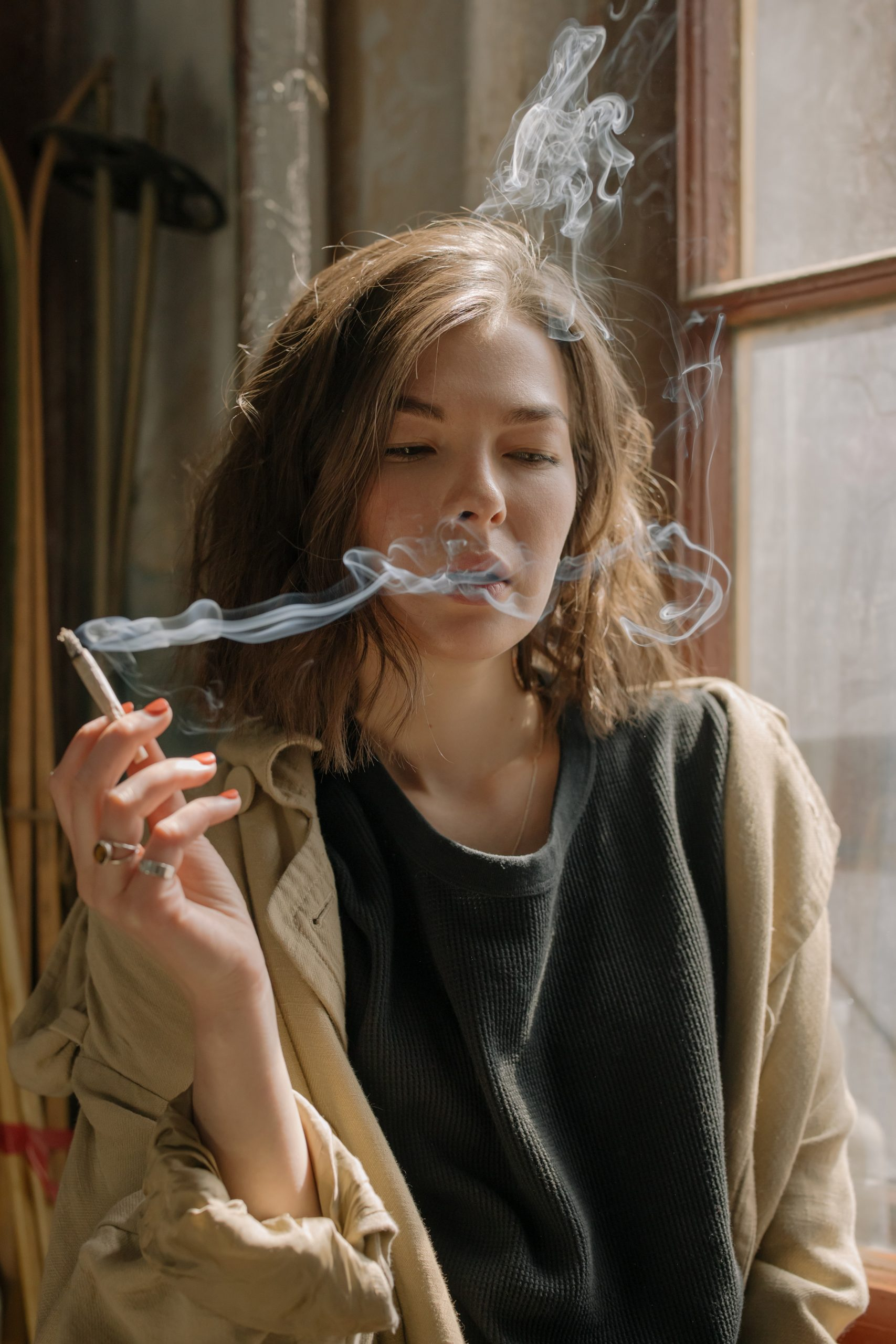 A woman smoking a hemp flower joint