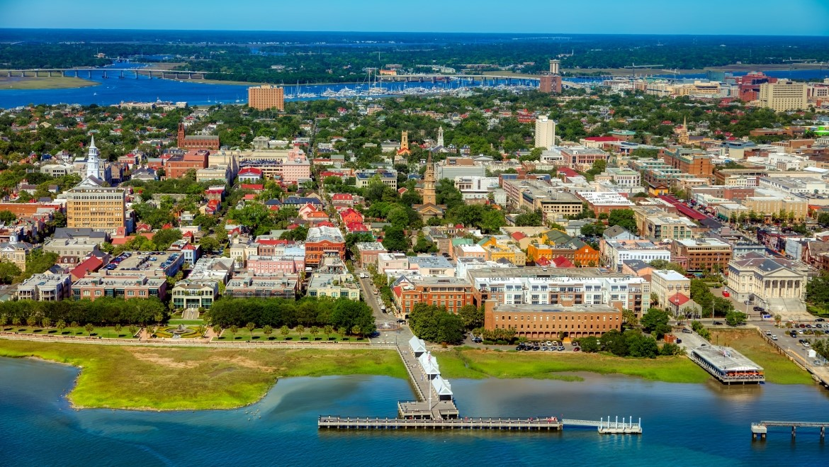 An aerial photo of Charleston South Carolina, the blue water glistening in the sunlight